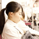 Japanese falling asleep on a train