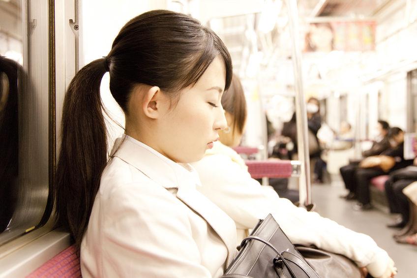 Japanese falling asleep on a train