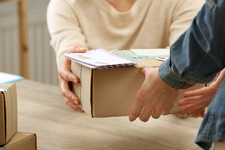 Cheapest way to ship personal goods from Japan