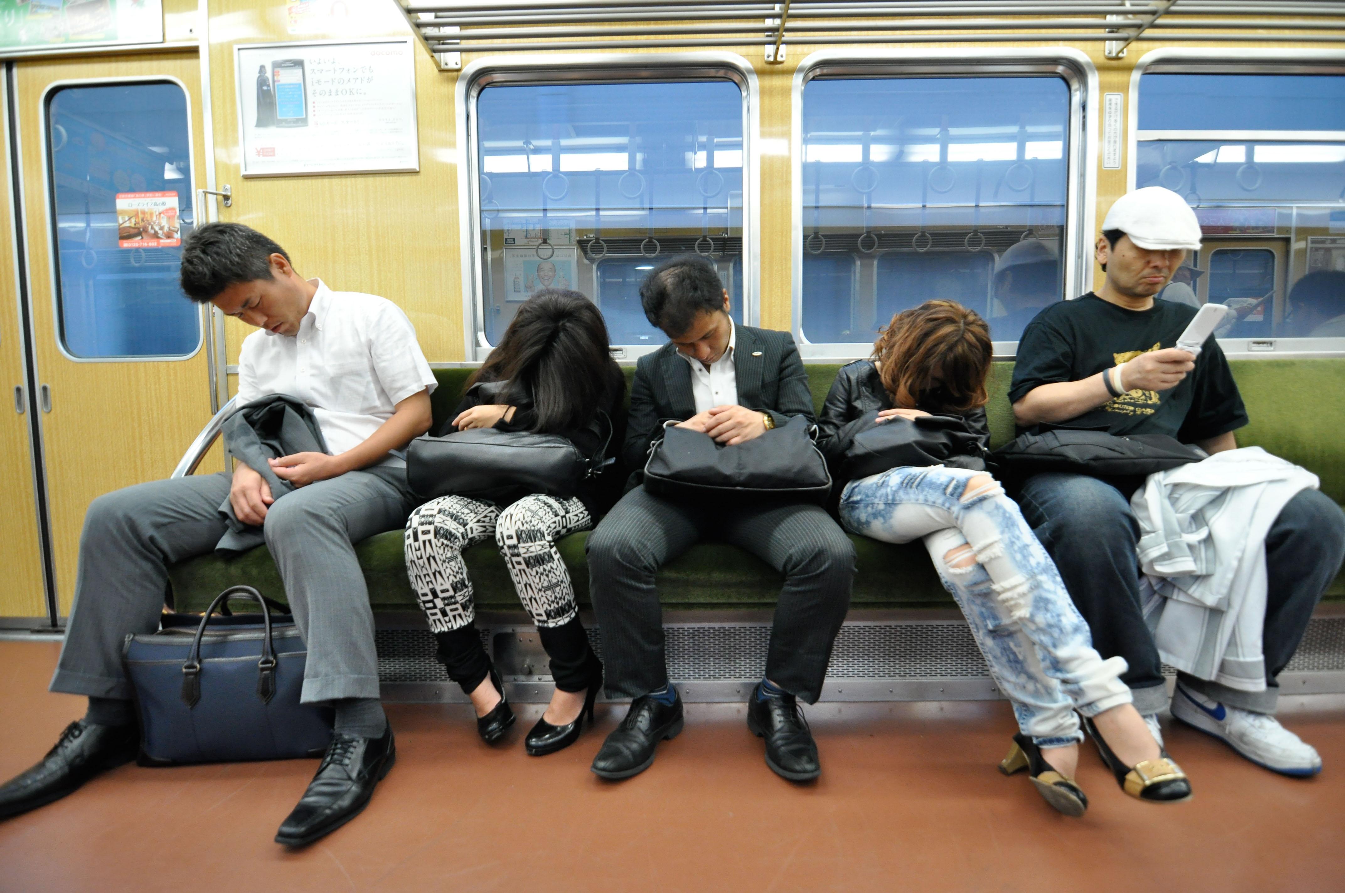 Why do Japanese people sleep on trains?